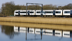 On track (82/366) (AdaMoorePhotography) Tags: uk blue england sun white lake reflection reed water train reeds spring nikon sunny gb publictransport essex day82 c2c 366 d7200