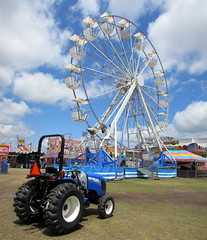 New Holland Workmaster Tractor Near The Ferris Wheel. (dccradio) Tags: sky tractor sc wheel festival clouds fun myrtlebeach ride southcarolina bluesky fair entertainment ag ferriswheel agriculture tractors countyfair amusements agricultural farmequipment carnivalride thrillride farmmachinery amusementride communityevent newholland myrtlebeachspeedway fairride horrycounty mechanicalride gondolawheel technicalpark amusementdevice horrycountyfair altmantractorofconway