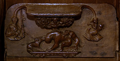 Enville, Staffordshire, St. Mary's, chancel, stalls, south side, misericord : muzzled bear (groenling) Tags: bear wood uk greatbritain england woman dog baby man tree britain carving pole chain gb shawl staffordshire chancel stalls woodcarving stmarys midlands staffs misericord enville