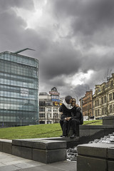 Cuddles (tootdood) Tags: sky people manchester couple sitting stormy sit sat seated cuddles urbis fromthehip cathedralgardens streetcandid canon70d
