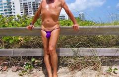 purple missile wall (bmicro2000) Tags: man male banana bikini thong tiny gstring rocket missile manthong minimalswimwear microkini microbeachwear