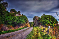 A country romance (Kevin_Jeffries) Tags: road sky cloud color colour tree beauty rural fence countryside interestingness interesting bush rocks bright country hill creative romance adventure story lane mysterious mostinteresting storybook fencepost nikond90
