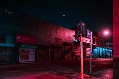 Johannesburg (elsableda) Tags: africa road city pink blue urban colors night dark southafrica traffic empty sony south emptiness johannesburg joburg