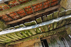 Under the roof (Johan Konz) Tags: wood roof red france building green abandoned loft farmhouse village outdoor decay painted ceiling diagonal tiles planks beams steeringwheel franchecomte hautesane vauvillers hurecourt