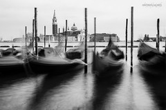 Gondola (Gioia & Andrea) Tags: wood longexposure venice light shadow sky blackandwhite cloud white black reflection water canon boat movement long exposure paint gray nd gondola murano palo venezia gondolier filtrer