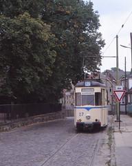 Germany - Woltersdorf - Tram through the village (railasia) Tags: sign germany wsb gutter brandenburg infra nineties reko singletrack motorcar cobblestonepavement woltersdorf routen87