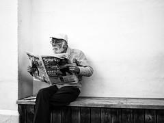 Paper (thomas.madhavan) Tags: hat beard newspaper seaside cigarette cardiff streetphotography older penarth