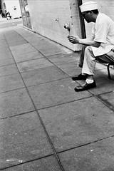 white socks (kuronakko) Tags: street bw film socks sitting break iso400 cigarette smoke droopy smoking sidewalk chef sit rest whitesocks leicam3 sfbas fujifilmneopan400 leicamsummilux50mmf14 bwfp