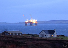 The Regalia Out Past Crook (orquil) Tags: uk greatbritain winter house seascape building islands scotland seaside nice interesting orkney afternoon january vessel illuminated cranes maritime rig resting unusual elevated accommodation visitor crook regalia semisubmersible litup sheltering scapaflow flotel orcades waulkmill prosafe awaitingredeployment shelteredanchorage orphirparish