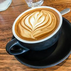 Flat white coffee at Little Somethin Somethin in Richmond