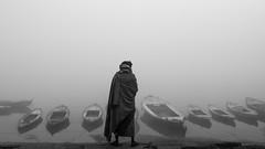 Monarch of all he surveys (1/4th) Tags: street blackandwhite bw india mist monochrome fog river boats nikon varanasi nikkor kashi ganga ganges ghats banaras benaras cwc uttarpradesh gangariver  varanasighats   2470mmf28g nikon2470mmf28 d7000 chennaiweekendclickers monarchofallhesurveys foggyghats cwc384