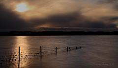 Incoming storm (growlerbrown) Tags: longexposure sun storm colour reflection clouds canon fence landscape reservoir barbedwire rutland rutlandwater