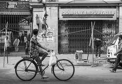 Street Circus (pathikdebmallik) Tags: road street india white black bicycle wall doors loudspeaker streetlife rope roadshow cycle posters rim tension kolkata calcutta observers catenary monocrome westbengal collapsible streetsofkolkata