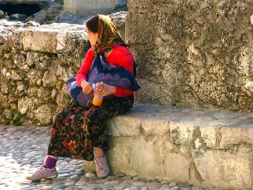 Roma woman with baby near Stari Most, Mostar, Bosnia & Hercegovina