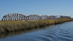 Louisiana swamp bridge (Pejasar) Tags: bridge blue sky water grass louisiana waves swamp ripples lakepontchartrain neworleansarea