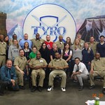 Criminal Justice students pose with inmates at a prison