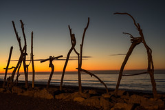 Hokitika (Myreality2) Tags: sunset sea newzealand sculpture beach events driftwood nz westcoast hokitika drillbits westcoastnz