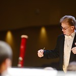 Dr. Greig conducting