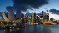 Singapore Skyline After Sunset (cyrillhaenni) Tags: city travel bridge blue light sunset sea sky urban panorama sun reflection building art water skyline museum architecture night clouds marina bay singapore cityscape science hour helix traveling beatiful