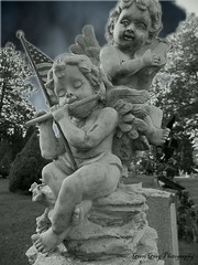 Glenwood Cemetery (Gerri Gray Photography) Tags: monochrome cemetery grave graveyard statue angel religious death memorial cherub gravestone mementomori winged tombstones gravemarker