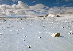 Rocks (and Maybe Meteorites) on Ice in Antarctica (sjrankin) Tags: ice clouds rocks edited antarctica nasa hills meteorite icefield 18april2016