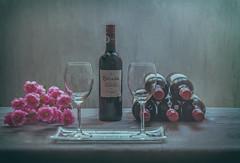 waiting for a friend (t.boelaars) Tags: flowers glass bottle wine stillife