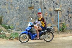 Thai kid riding a bike (srgrumyantsev) Tags: red bike hair thailand kid ride transport scooter riding motorcycle