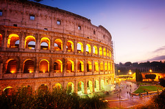 Colosseum in Rome, Italy (noor.khan.alam) Tags: old travel blue light sunset summer sky italy rome roma building brick history monument stone architecture night italian ancient ruins europe theater european day arch exterior roman outdoor dusk stadium forum famous ruin arc culture landmark historic colosseum arena empire historical coliseum amphitheater belarus colosseo illuminted