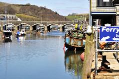 Bridge East to West Looe (armadillo1945) Tags: uk bridge river boats fishing cornwall colours arches looe moorings