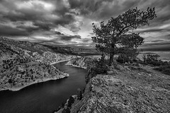 The Miracle Mile I (ajschroetlin) Tags: light shadow sky blackandwhite mountains nature monochrome weather clouds dark landscape landscapes colorado rocks skies denver wyoming select pristine ajschroetlin andyschroetlin