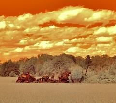 Relics (Neal3K) Tags: orange abandoned clouds ir rust trucks infraredcamera henrycountyga kolarivisionmodifiedcamera