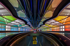 Face forward - No bare feet (JohnNguyen0297) Tags: light chicago vanishingpoint airport colorful perspective symmetry ohare walkway vanishing ord 1018mm a6000 sel1018 ilce6000 johnnguyen0297