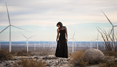 GBI_4219 (GBImaging) Tags: california blue portrait sky woman mountains windmill cali lady female clouds photo model sand energy rocks power dress desert sandiego picture pic professional ambient greenpower gbimaging gbimaging7