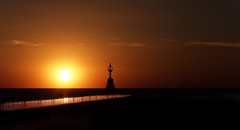 Lighthouse at sunset - Silhouette (Giuseppe Tripodi) Tags: light sunset red sea sky orange sun lighthouse beach nature silhouette yellow landscape outside tramonto cielo nikkor