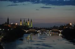 Zaragoza de noche (Luis Gracia Pinilla) Tags: rio night puente noche y cloudy covered nubes partly claros cubierto