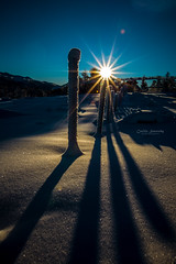 Winter shadows (nemi1968) Tags: blue winter shadow sky sun sunlight snow norway canon fence shadows january bluesky flare sunrays sunbeams sunstar markiii canon5dmarkiii asunflare