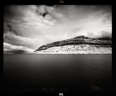 The Sleeping Giant (tsiklonaut) Tags: ocean sea sky bw cloud white seascape black 120 film blanco monochrome clouds analog landscape ir mono islands bay y pentax drum scanner negro tube dramatic surreal atmosphere scan atlantic blanket infrared roll peek medium format fjord analogue 6x7 aura 67 atmospheric analogica faroe mustvalge efke drumscan analoog pmt infrapuna maastik ulme ir820 saared photomultiplier atmosfr fri ulmeline