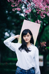 Hidy (I C E I N N) Tags: pink blue trees portrait people flower girl leaves yellow shirt painting asian 50mm blurry moody dof photoshoot bokeh outdoor sony navy canvas jeans e denim sakura fe melancholy   speedmaster gaze creamy f095  zhongyi hidy mitakon  sonya7ii ilce7m2