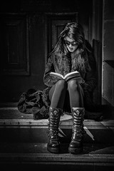 Woman reading on steps - Great boots! (Daz Smith) Tags: city uk portrait people urban blackandwhite bw woman streets blancoynegro monochrome leather canon skulls reading book blackwhite bath boots candid steps citylife thecity streetphotography sat canon6d dazsmith bathstreetphotography
