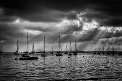 Yachts under the storm (Ravikumar Jambunathan) Tags: ocean city travel sea beach nature water rain clouds singapore sailing yacht outdoor sail sunrays ravikumar jambunathan