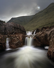Out of a hole in the sky (kenny barker) Tags: sky clouds dawn scotland waterfall rocks glencoe