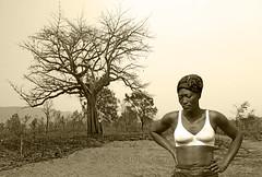 Togo, Kabiye tribe woman & dried baobab tree #Tg (bilwander) Tags: travel african mount solo westafrica togo tribe blackwoman whitebra adansonia bilwander kabiye kaybe tg
