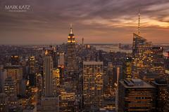 Golden empire (markkatzphotography) Tags: nyc newyorkcity sunset usa newyork clouds canon worldtradecenter gotham metropolitan eastcoast urbanlandscape cityviews movingclouds beautifulsunsets oneworldtrade markkatzphotography