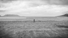 H U G E (andresenra) Tags: ocean sea bw white black mountains beach clouds kid sand center tiny huge grayscale