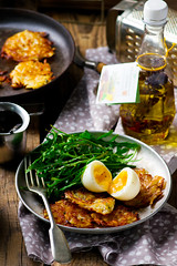 potato fritters with egg and  green salad (Zoryanchik) Tags: food cooking pancakes dinner recipe lunch cuisine golden potatoes dish background plate vegetable crispy potato snack meal vegetarian carrot eggs onion pancake parsley fried patties fritters prepared fritter