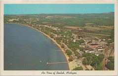 """NW Beulah Benzonia MI Beautiful Crystal Lake & Downtown Village Aerial View from US 31 at M-115 Junction East End of Crystal Lake looking to Mitchell Estate & Crystal Drive Photo PHIL BALYEAT (UpNorth Memories - Donald (Don) Harrison) Tags: travel usa heritage history tourism st vintage antique michigan postcard memories restaurants hotels trailer roadside upnorth steamship cafes excursion attractions motels mackinac cottages cabins campgrounds city"""" bridge"""" island"""" """"car upnorthmemories rppc wonders"""" """"big """"railroad """"michigan memories"""" mac"""" """"state parks"""" entertainment"""" """"natural harrison"""" """"roadside ferry"""" """"travel """"don """"tourist """"mackinaw puremichigan stops"""" """"upnorth straits"""" ignace"""""""