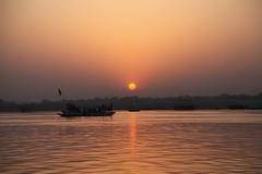 The Sun rises over the Ganges (Heaven`s Gate (John)) Tags: sky people sun india reflection nature water sunrise river dawn boat mood atmosphere varanasi ganges 10faves 25faves johndalkin heavensgatejohn canoneos5dmarkii