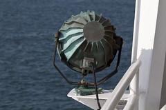 Back of the Lamp (brucetopher) Tags: ocean light sea green water lamp ferry marthas vineyard spotlight marthasvineyard lantern patina