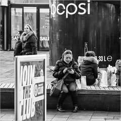 Join the club (John Riper) Tags: street bw white black eye netherlands girl monochrome sign club canon john river bench photography rotterdam phone sale candid smartphone join l pepsi contact snacks mediamarkt texting 6d 24105 straatfotografie riper johnriper