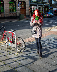 Red and Green Everywhere (Jomak1) Tags: street shadow red woman colour green london bike bicycle mobile lady female scarf hair photography long shadows phone coat january workshop rps woolwich 2016 jomak1